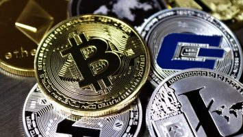 Cryptocurrency coins on table